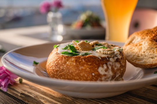 Clam Chowder in bread with crackers