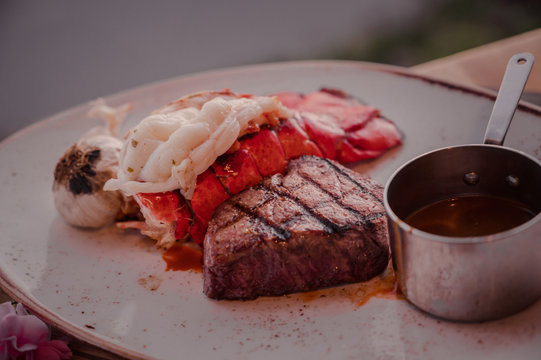 Steak and Lobster dish with sauce