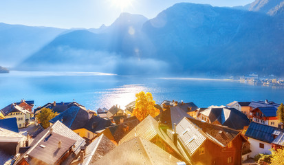 Wall Mural - Panorama of Hallstatt village and Hallstatter lake in Austria, spectacular seasonal autumn sunrise scene. View over old historical architecture. UNESCO world heritage site, iconic travel landmark.