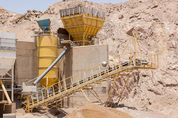 not working industrial tower building in abandoned mine territory in desert polluted region , environmental concept object picture
