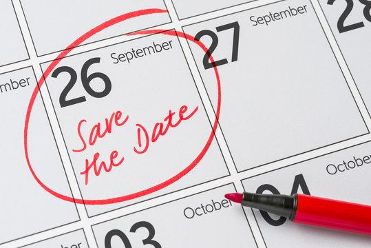 Save the Date written on a calendar - September 26