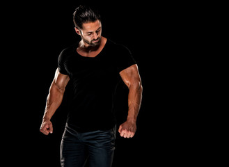 Handsome Male Fitness Model Wearing Jeans and Black T-Shirts