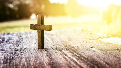 Wooden cross on background . Closeup of wooden Christian cross