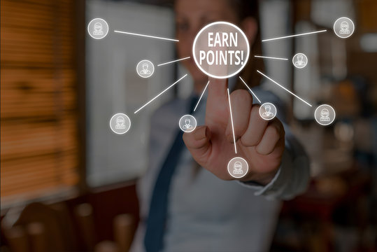 Conceptual hand writing showing Earn Points. Concept meaning collecting scores in order qualify to win big prize Woman wear suit presenting presentation using smart device