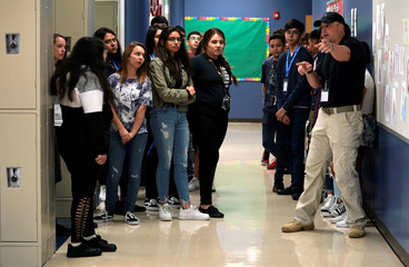 Joe Deedon, president of TAC*ONE, shows Pinnacle Charter School high school students an evacuation procedure during TAC*ONE training for an active shooter situation in a school in Thornton