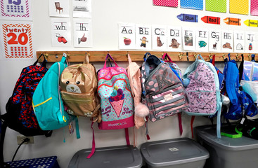A row of colorful backpacks belonging to first graders line the wall at Pinnacle Charter School during TAC*ONE training for an active shooter situation in a school in Thornton