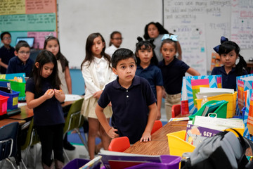Second grade students at Pinnacle Charter School listen to an instructor during TAC*ONE training for an active shooter situation in a school in Thornton