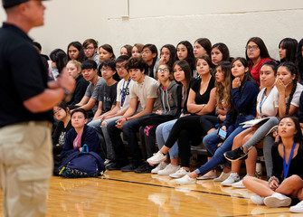 Joe Deedon, president of TAC*ONE, speaks to hundreds of Pinnacle Charter School high school students during TAC*ONE training for an active shooter situation in a school in Thornton