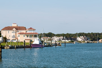 Homes and boats on Lake Wesley at Rudee Inlet in Virginia Beach, Virginia.