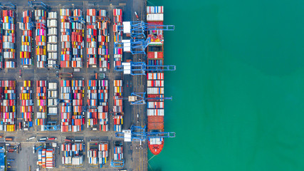 Container ship loading and unloading in deep sea port, Aerial top view of business logistic import and  export freight  transportation by container ship in open sea. Fototapete