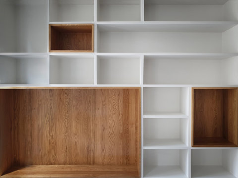 Empty closet shelves background. Modern wooden wardrobe boxes, beautiful white and brown interior design combination, abstract shape and patterns.