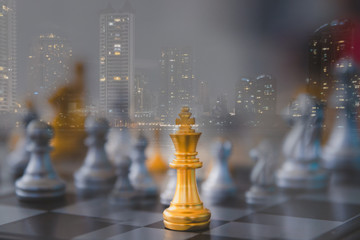 Double exposure image of chess and cityscape. Leadership of leaders will lead the team to success in business together with business of corporation.