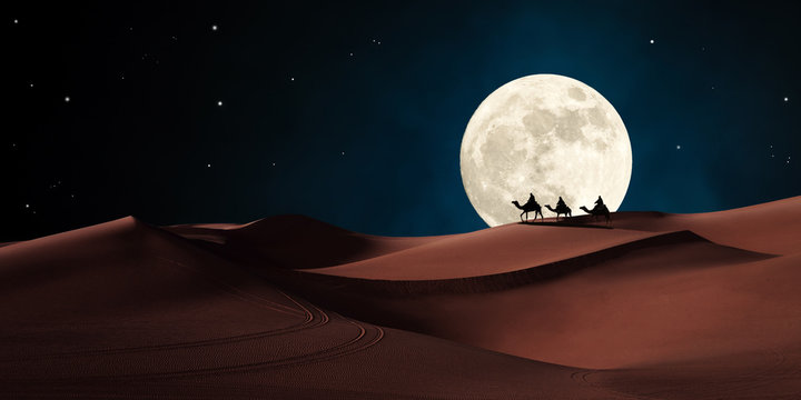 Three wise men riding on camels traveling in the desert