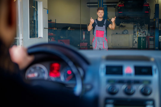Mechanic welcomes new client to his auto repair service