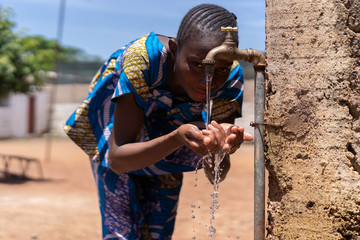 Candid picture of African Black Girl Drinking Water Bamako Mali