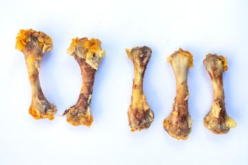 Five Chicken Bones in Leg on abstract white background