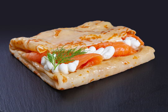 Pancake with salmon and cheese