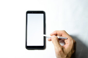 Electronic signature by a male hand on a smartphone with a black frame on a white background close, top, side