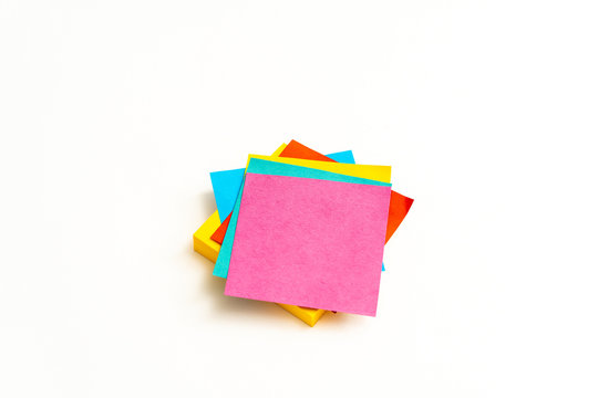 Stack of colorful post-it note on white background