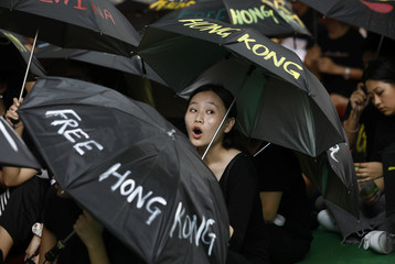 A Tibetan exile shouts slogan during a protest to support Hong Kong pro-democracy protestors, in New Delhi