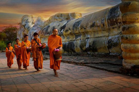 Monks and novices at Phra Non Temple, Wat Lokayasutharam Phra Nakhon Si Ayutthaya District