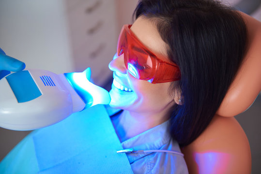 Happy woman with eyes closed in dentist chair