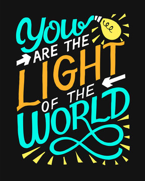 Hand lettering with bible verse You are the light of the world on black background