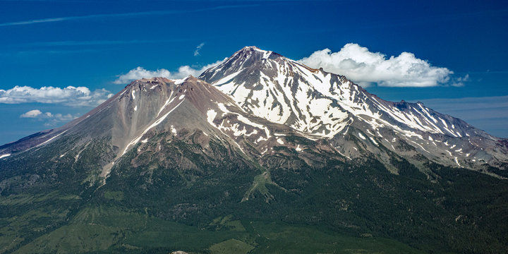 Mt. Shasta photographed on sunny summer day, snow-capped volcano one of Northern California's tallest mountains