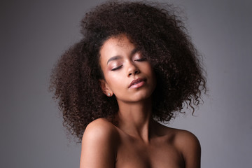 Intimate portrait of afro-amercian girl with such beautiful face.