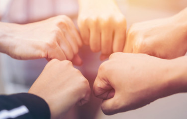 close up of hand people do gestures fist bump after working deal successful together. Charities, friendship, unity and cooperation Concept