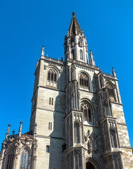 Fototapete - Konstanz Minster or Cathedral of Constance city, Germany. It is a landmark of old town of Constance. Facade of medieval Gothic church in summer. Ornate ancient European architecture against blue sky.