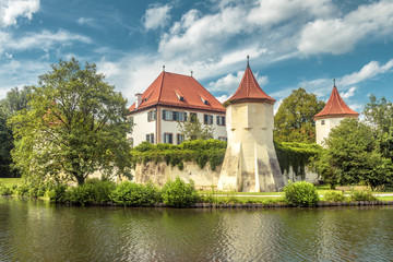 Fototapete - Blutenburg Castle in Munich, Germany. It is an old landmark of Munich city. Scenic view of medieval architecture of Munich in summer. Beautiful panorama of ancient castle on Wurm River in Bavaria.