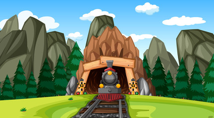 Train exiting tunnel in mountain