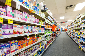 CHATHAM, NJ, UNITED STATES - JULY 31, 2014: Aisle in a CVS pharmacy.  CVS is the second largest pharmacy chain in the United States with more than 7,600 stores and ranked as the 13th largest company i