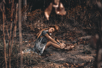 Foto op Aluminium People beautiful young boho style woman sitting on ground outdoors
