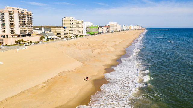 Aerial Perspective Couple Walking Along the Beach in Ocean City Maryland