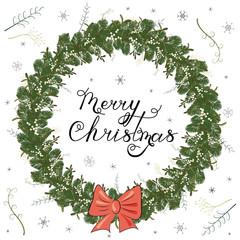 Christmas fir wreath with mistletoe and bow.