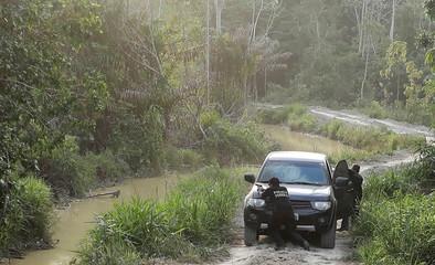 Federal Police officers shoot suspected loggers during an operation conducted jointly with the Brazilian Institute for the Environment and Renewable Natural Resources (IBAMA) at an illegal gold mine near the city of Altamira