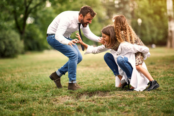 parent with their daughter after school have fun together outdoor.