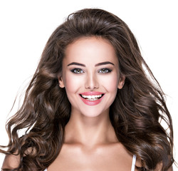 Beautiful laughing woman with long brown hair.