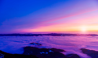 Photo sur Plexiglas Bleu fonce beautiful sunset or sunrise above the clouds. Romania