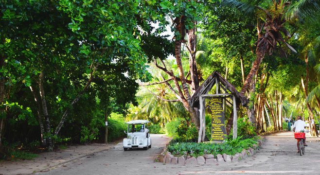 La Digue, Seychelles:  Entry to Union Estate Park with coconut  Palm Trees, vanilla plantation and lush green vegetation