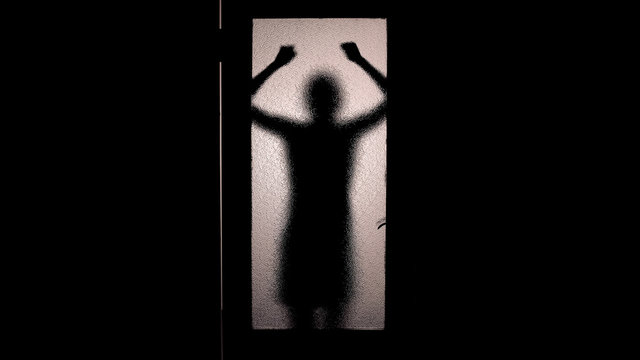 Hopeless woman knocking with fists at closed door, running from murderer, fear