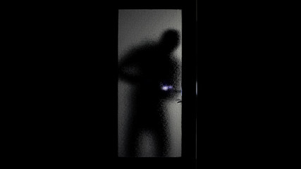 Bandit shadow with flashlight and crowbar breaking into house, no alarm system - fototapety na wymiar