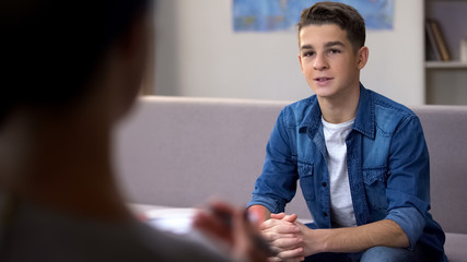 Male teenager on professional skills consultation before entering university