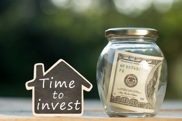 Time to Invest written on the little house shape tag - real estate concept