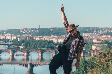 the man dancing break with happiness. beautiful view of the old city of Prague, Praha, tourist tour in Europe, vacation. having fun. copy space Fototapete