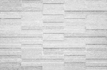 Modern polished granite tile wall pattern texture background in natural grey color