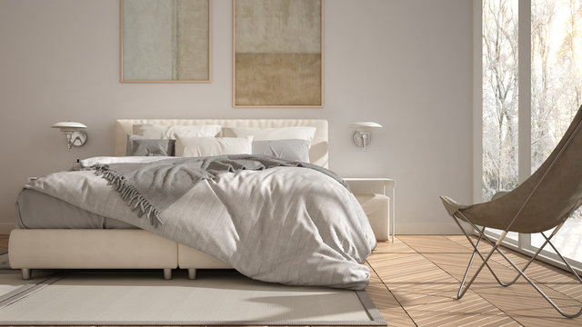 Modern white minimalist bedroom, double bed with pillows and blankets, parquet, bedside tables and carpet. Panoramic window with winter panorama with trees and snow, interior design