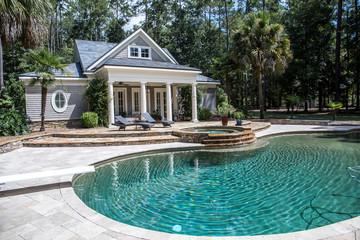 Printed kitchen splashbacks Khaki Custom pool House behind a landscaped estate with a large swimming pool and hot tub